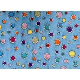 Ronds multicolores cirés sur bleu ciel